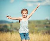 Little girl runs through a meadow — Stock Photo