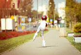 Little girl rollerblading — Stock Photo