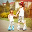 Two little sisters in a roller skates — Stock Photo #54533401