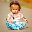 Girl in roller skates and a helmet — Stock Photo #54535223