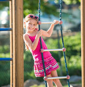 Little girl on  playground — Stock Photo