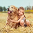 Little girl with her dog — Stock Photo #57753355
