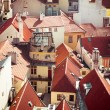 Houses with traditional red roofs in Prague — Stock Photo #58585123