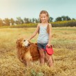 Little girl with her dog — Stock Photo #59275071