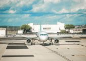 The plane at the airport — Stock Photo