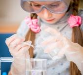 Girl with flasks for chemistry — Stok fotoğraf