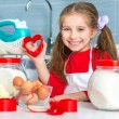 Little girl holding a cookie cutter — Stock Photo #61554203