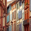 Street with old buildings in Toulouse — Stock Photo #61556153