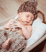 Newborn boy  asleep in  basket — Stock Photo