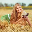 Young woman with her dog — Stock Photo #64309223