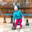 Girl playing strategic outdoor — Foto de Stock   #64329995