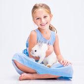 Little girl with white rabbit — Stok fotoğraf