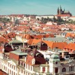 Houses with traditional red roofs in Prague — Stock Photo #69810521