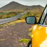 Yellow car on  mountains — Stock Photo #70003373