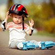 Two year old  girl in roller skates and a helmet — Stock Photo #71898611