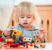 Cute girl playing with constructor — Stock Photo