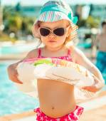 Little cute girl near the pool — Stock Photo
