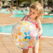 Little  girl near the pool — Stock Photo