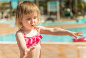 Little  girl sitting near the pool — Photo
