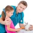 Doctor  and little girl with rabbit — Stock Photo #71950143
