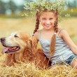 Happy little girl with dog — Stock Photo #71966657
