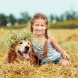 Happy little girl with  dog — Stock Photo #71966709