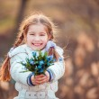Little girl with  snowdrops — Stock Photo #71968905
