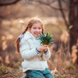 Little girl with  snowdrops — Stock Photo #71968941