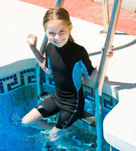 Cute little girl in  wetsuit — Stock Photo