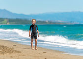 Happy little girl in  wetsuit — Stock Photo