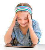 Little girl and tablet — Stock Photo