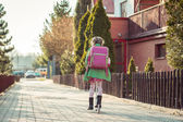 Girl goes to school  on  scooter — Stock Photo