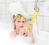 Girl in sunglasses dive with  tube — Stock Photo