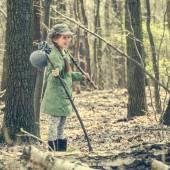 Little girl goes through  woods — Stock Photo