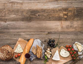 French snacks on a wooden table — Stock Photo