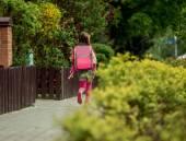 Little girl  run to school — Stock Photo