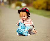 Two year old  girl in roller skates and a helmet — Stock Photo