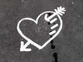 Abstract love symbol on pavement — Stock Photo