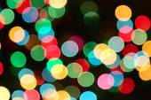 Holiday background with colorful unfocused lights — Stock Photo