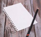Black pencil and sheet — Stock Photo