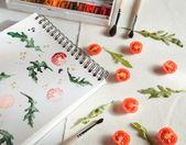 Cherry tomatoes ans arugula — Stock Photo
