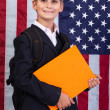 Schoolboy holding book — Stock Photo #56227901