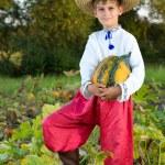 Boy holding pumpkin — Stock Photo #56228865