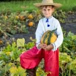 Boy holding pumpkin — Stock Photo #56228873