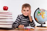Cute schoolboy writting — Стоковое фото