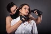 Taking woman as hostage — Stock Photo