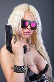 Beautiful sexy girl with guns — Stock Photo