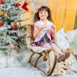 Little girl with gifts under the Christmas tree — Stock Photo #59281083