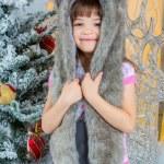 Cute little happy girl posing in a fur hat. — Stock Photo #59281195