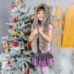 Cute little happy girl posing in a fur hat. — Stock Photo #59281211